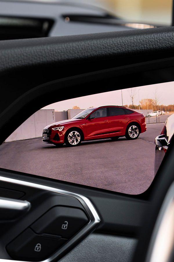 Red Etron Sportback electric car through car door
