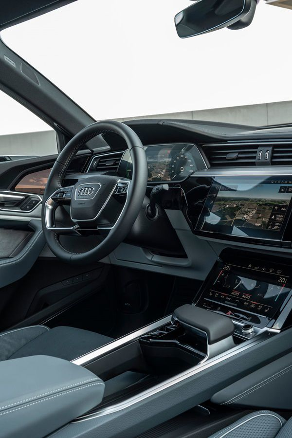 Audi Etron sportback grey interior with digital touchscree and steering