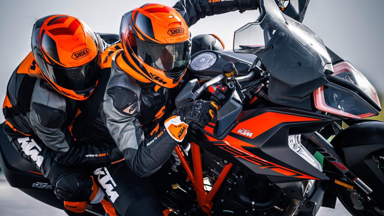 Black KTM 1290 SuperDuke GT with pillion